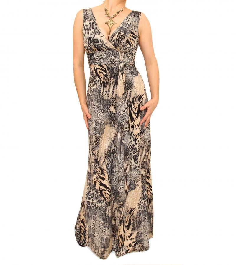 Animal print maxi dress has thin halter top straps, bloused bust with jeweled buckle ornament, and wide elastic waist. Unlined.